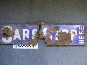 blue and white rusted railway sign