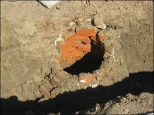 a hole in the ground lined with bricks