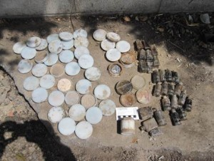 round and cylindrical containers laid out on the ground